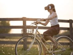 A bike rider using a headset to interact with entertainment and virtual reality. Photo by: Sebastian Voortman