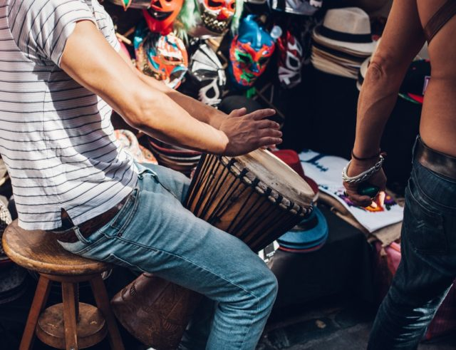 Musician performing on the street. Photo by: Clem Onojeghuo / pexels.com