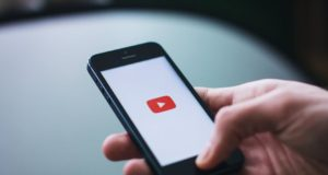 A smartphone user opening the YouTube application. Photo by: Pexels.com