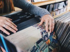 A shopper looks over vinyl records before Black Friday. Photo by: Pexels.com