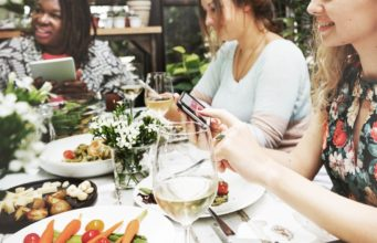 Mobile search during a social gathering. Photo by: Pexels.com