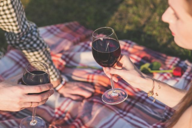 Wine and romance during sunset. Photo by: Pexels.com