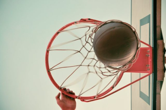 A basketball player dunking a ball. Photo by: Pexels.com