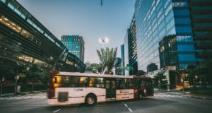 Bus driving in an urban setting. Photo by: Kaique Rocha / Pexels.com