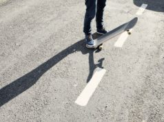 A skateboarder on the street. Photo by: Pexels.com