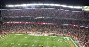 Guests cheer on the Denver Broncos at Mile High Stadium. Photo by: Matthew McGuire