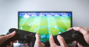 Gaming with Playstation. Photo by: Pexels.com