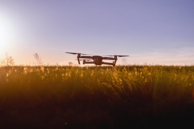 Drone flying over a field. Photo by: JESHOOTS.com / Pexels.com