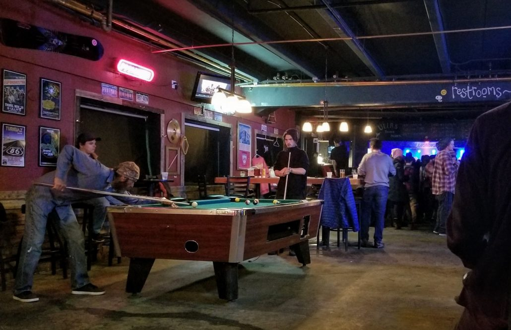 Guests playing pool at Ullrs Tavern on 04/08/18. Photo by: Matthew McGuire