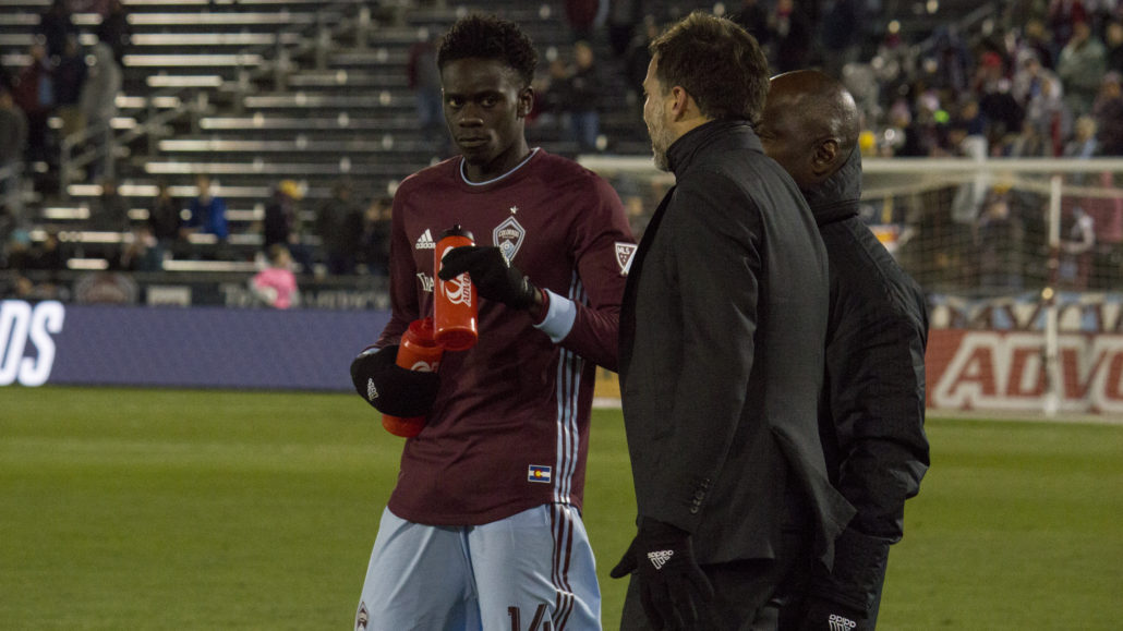 Dominique Badji speaking with the Colorado Rapids coaches on Saturday, March 31, 2018. Photo by: Matthew McGuire