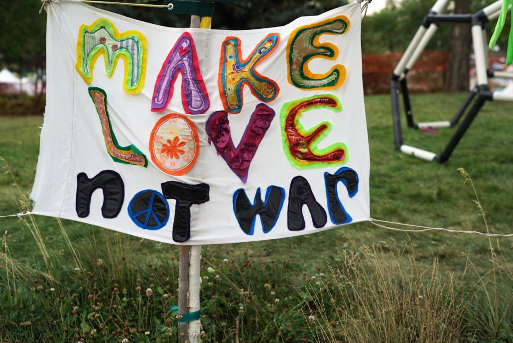 A sign supporting the power of love at ARISE 2018. Photo by: Samantha Harvey