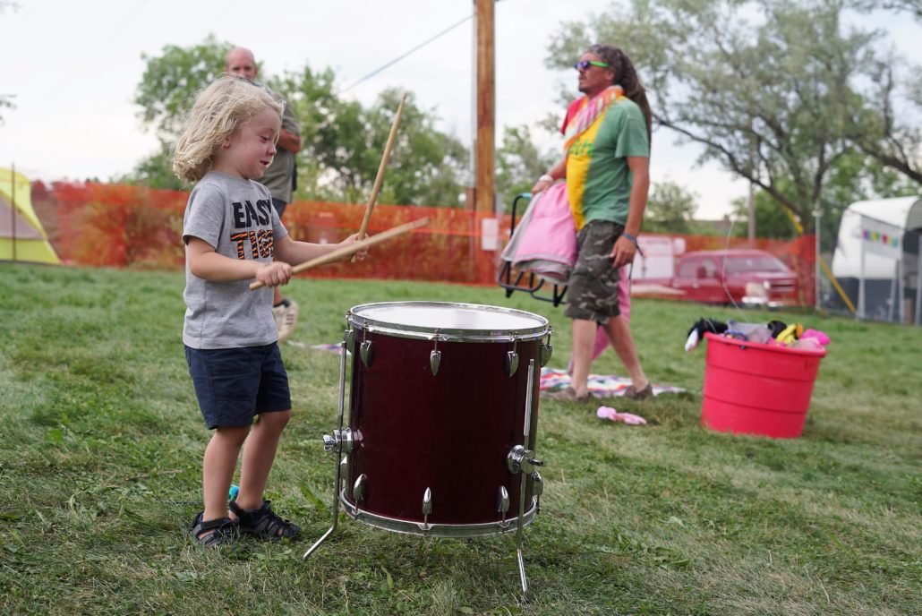 Guests try out drumming in the Children's Village. Photo by: Samatha Harvey